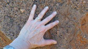 hand alone on Uluru